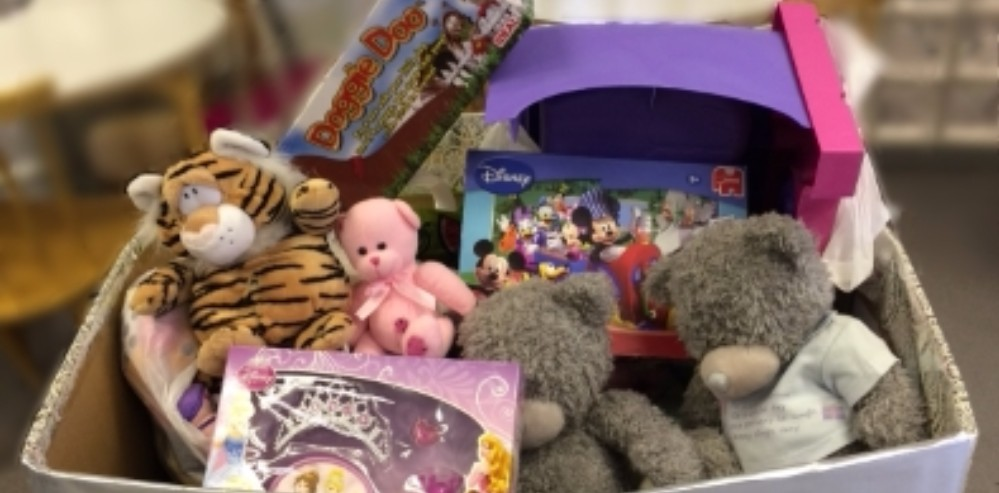 Capito donating toys to RiverKids charity