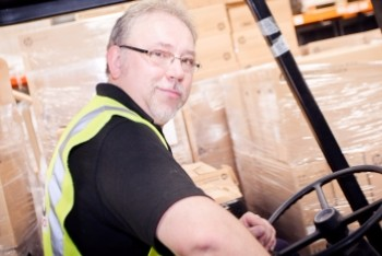 Capito male member of staff in warehouse truck
