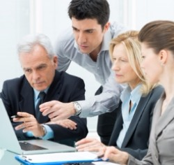 Capito Citrix Silver Partner, Sharefile, two males and two females gathered around a laptop