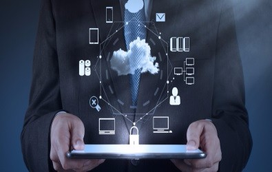 Capito CloudEnable - male holding laptop with icons of cloud applications
